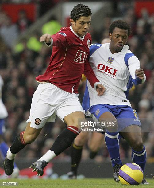 Cristiano Ronaldo of Manchester United clashes with Manuel Fernedes of Portsmouth the Barclays Premiership match between Manchester United and...