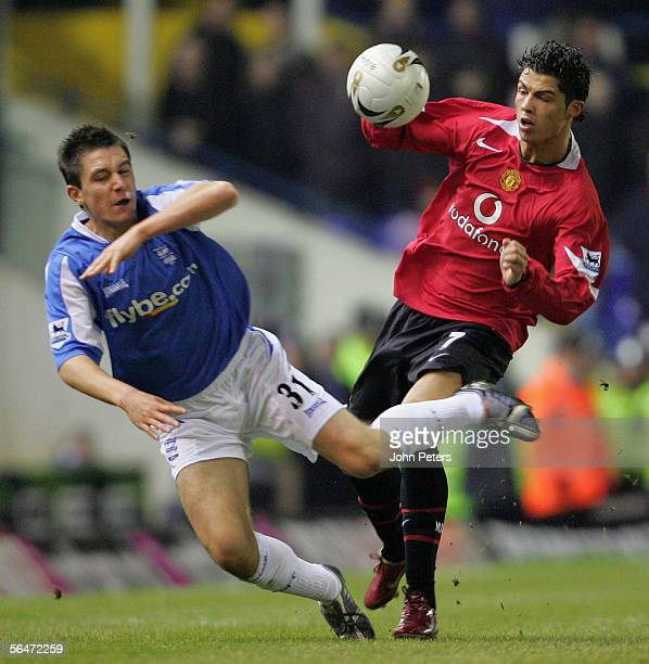 Cristiano Ronaldo of Manchester United clashes with Marcos Painter of Birmingham City during the Carling Cup quarterfinal match between Birmingham...