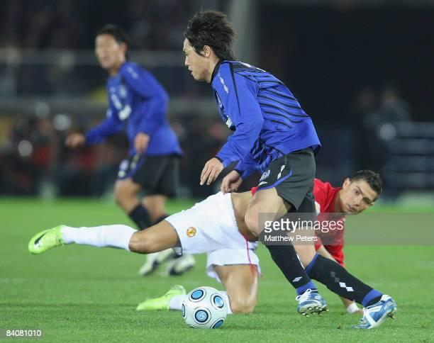 Cristiano Ronaldo of Manchester United clashes with Masato Yamazaki of Gamba Osaka during the FIFA World Club Cup Semi-Final match between Gamba...