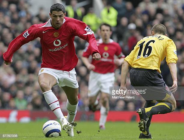 Cristiano Ronaldo of Manchester United clashes with Mathieu Flamini of Arsenal during the Barclays Premiership match between Manchester United and...