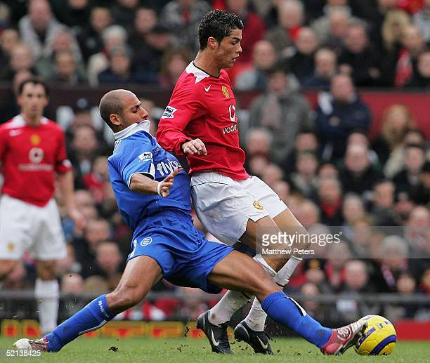 Cristiano Ronaldo of Manchester United clashes with Mehdi Nafti of Birmingham City during the Barclays Premiership match between Manchester United...