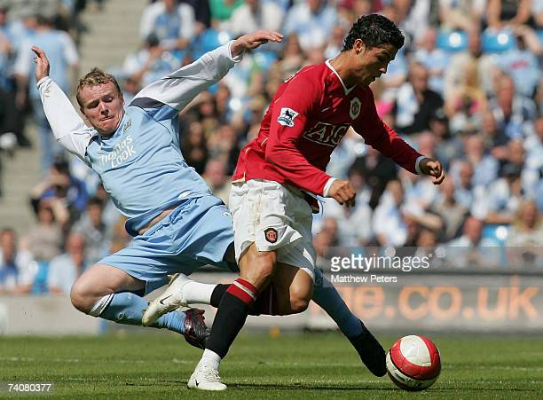 Cristiano Ronaldo of Manchester United clashes with Michael Ball of Manchester City during the Barclays Premiership match between Manchester City and...