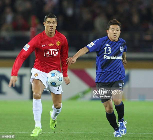 Cristiano Ronaldo of Manchester United clashes with Michihiro Yasuda of Gamba Osaka during the FIFA World Club Cup Semi-Final match between Gamba...