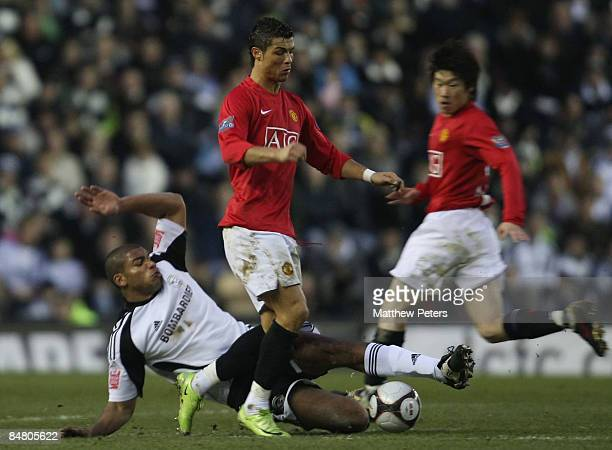 Cristiano Ronaldo of Manchester United clashes with Miles Addison of Derby County during the FA Cup sponsored by eon Fifth Round match between Derby...