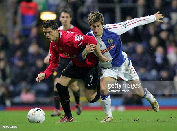 Cristiano Ronaldo of Manchester United clashes with Morten Gamst Pedersen of Blackburn Rovers during the Carling Cup semifinal first leg match...