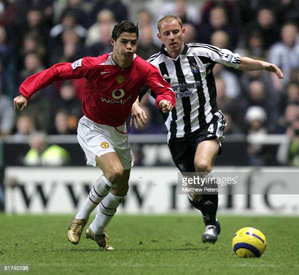 Cristiano Ronaldo of Manchester United clashes with Nicky Butt of Newcastle United during the Barclays Premiership match between Newcastle United and...