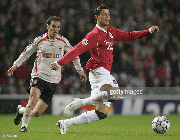 Cristiano Ronaldo of Manchester United clashes with Petit of Benfica during the UEFA Champions League match between Manchester United and Benfica at...