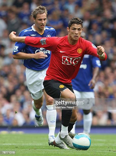 Cristiano Ronaldo of Manchester United clashes with Phil Jagielka of Everton during the Barclays FA Premier League match between Everton and...