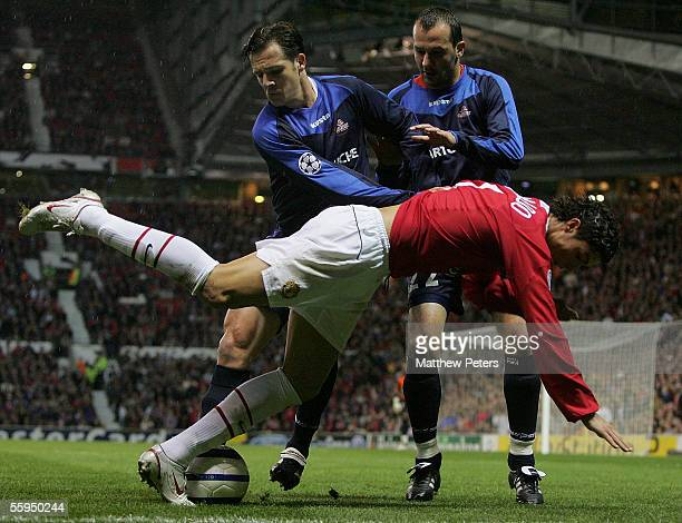 Cristiano Ronaldo of Manchester United clashes with Rafael and Milivoje Vitakic of Lille during the UEFA Champions League match between Manchester...