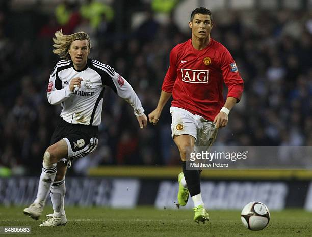 Cristiano Ronaldo of Manchester United clashes with Robbie Savage of Derby County during the FA Cup sponsored by eon Fifth Round match between Derby...