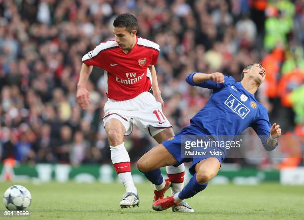 Cristiano Ronaldo of Manchester United clashes with Robin van Persie of Arsenal to win the freekick that led to their second goal during the UEFA...