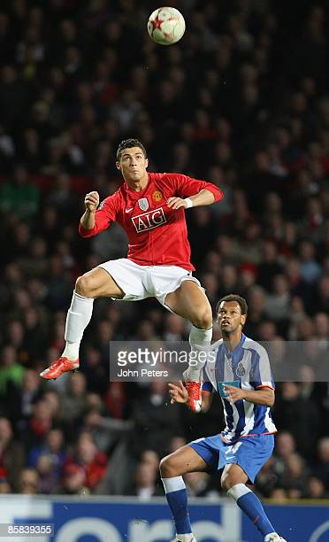 Cristiano Ronaldo of Manchester United clashes with Rolando of FC POrto during the UEFA Champions League QuarterFinal First Leg match between...