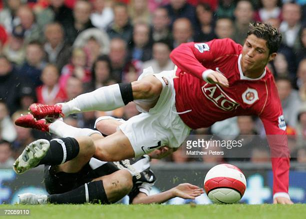 Cristiano Ronaldo of Manchester United clashes with Scott Parker of Newcastle United during the Barclays Premiership match between Manchester United...