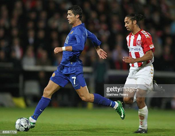 Cristiano Ronaldo of Manchester United clashes with Steve Olfers of Aalborg BK during the UEFA Champions League Group E match between Aalborg BK and...