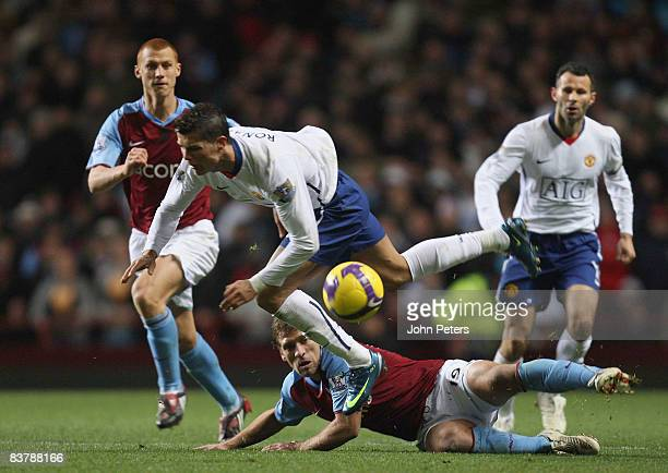 Cristiano Ronaldo of Manchester United clashes with Stiliyan Petrov of Aston Villa during the Barclays Premier League match between Aston Villa and...