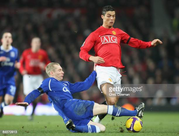 Cristiano Ronaldo of Manchester United clashes with Tony Hibbert of Everton during the Barclays Premier League match between Manchester United and...