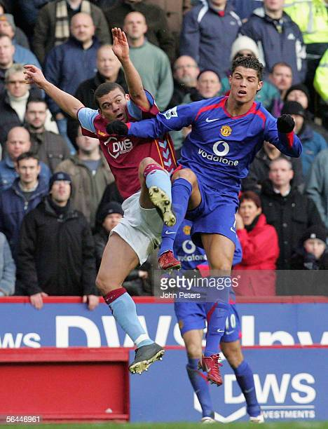 Cristiano Ronaldo of Manchester United clashes with Wilfred Bouma of Aston Villa during the Barclays Premiership match between Aston Villa and...