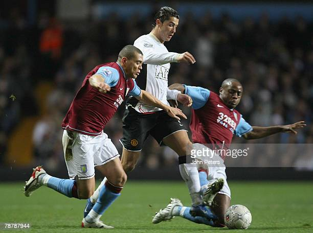 Cristiano Ronaldo of Manchester United clashes with Wilfred Bouma of Aston Villa during the FA Cup sponsored by e.on Third Round match between Aston...