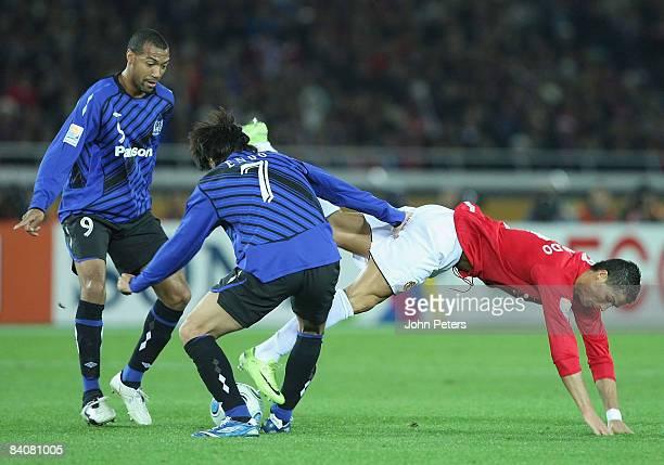 Cristiano Ronaldo of Manchester United clashes with Yasuhito Endo of Gamba Osaka during the FIFA World Club Cup Semi-Final match between Gamba Osaka...