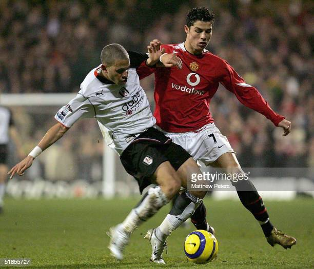 Cristiano Ronaldo of Manchester United clashes with Zesh Rahman of Fulham during the Barclays Premiership match between Fulham and Manchester United...
