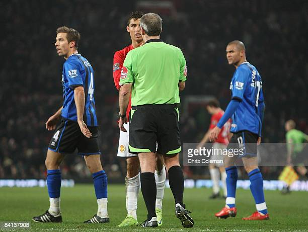 Cristiano Ronaldo of Manchester United complains to referee Martin Atkinson during the Barclays Premier League match between Manchester United and...