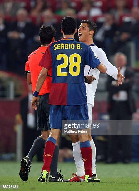 Cristiano Ronaldo of Manchester United complains to referee Massimo Busacca during the UEFA Champions League Final between FC Barcelona and...