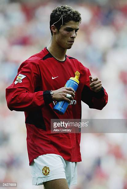 Cristiano Ronaldo of Manchester United enjoys a drink of Lucozade Sport during the FA Barclaycard Premiership match between Manchester United and...