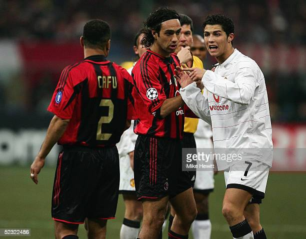 Cristiano Ronaldo of Manchester United exchanges words with Cafu of AC Milan during the UEFA Champions League match between AC Milan and Manchester...