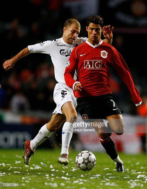 Cristiano Ronaldo of Manchester United gets away from Hjalte Norregaard of FC Copenhagen during the UEFA Champions League Group F match between FC...