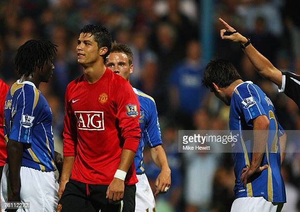 Cristiano Ronaldo of Manchester United grimaces as Referee Steve Bennett points to the sideline after showing him the red card for his involvement in...