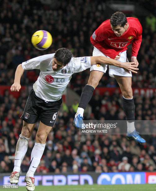 Cristiano Ronaldo of Manchester United heads his second goal past Dejan Stefanovic of Fulhamduring the Premier league football match, 03 December...