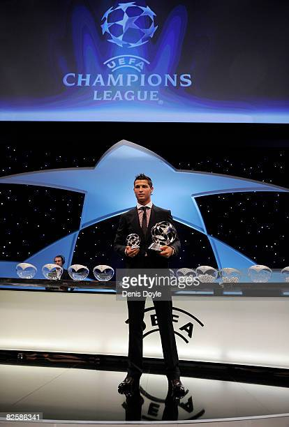 Cristiano Ronaldo of Manchester United holds his award for Player of the Year at the UEFA Champions League Draw for the 2008/2009 season at the...
