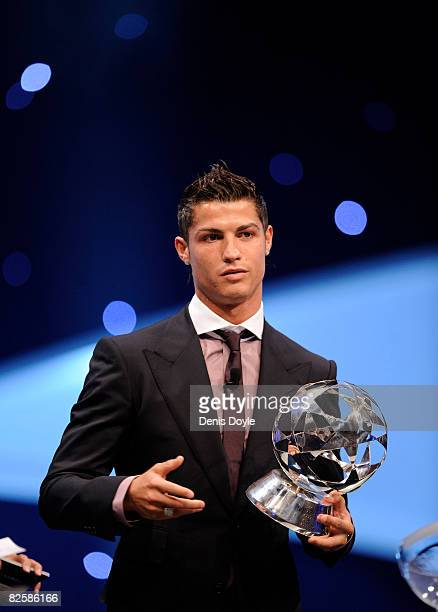 Cristiano Ronaldo of Manchester United holds his award of Player of the Year at the UEFA Champions League Draw for the 2008/2009 season at the...