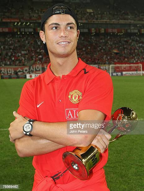 Cristiano Ronaldo of Manchester United holds his Man of the Match award after the preseason friendly match between FC Seoul and Manchester United at...