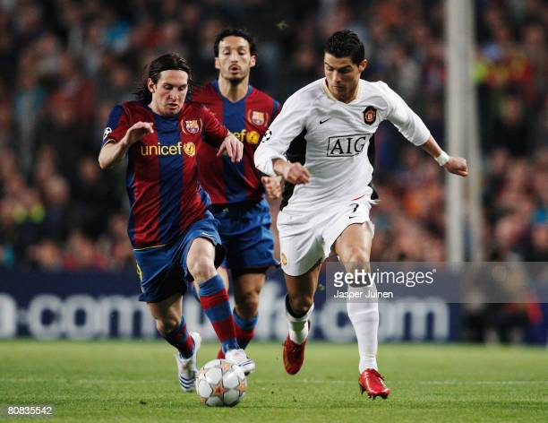 Cristiano Ronaldo of Manchester United holds off the challenge of Lionel Messi of Barcelona during the UEFA Champions League Semi-Final, first leg...