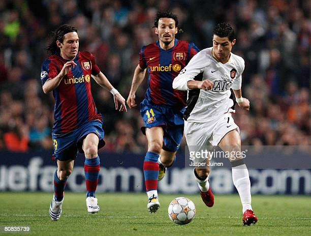 Cristiano Ronaldo of Manchester United holds off the challenge of Gianluca Zambrotta and Lionel Messi of Barcelona during the UEFA Champions League...