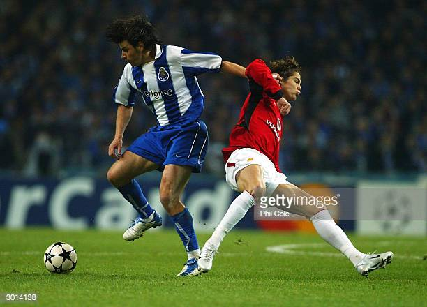Cristiano Ronaldo of Manchester United is beaten to the ball by Nuno Valente of FC Porto during the UEFA Champions League second round first leg...