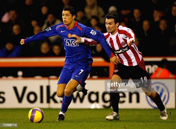 Cristiano Ronaldo of Manchester United is challenged by Keith Gillespie of Sheffield United during the Barclays Premiership match between Sheffield...