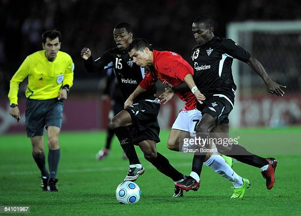 Cristiano Ronaldo of Manchester United is challenged by William Araujo and Neicer Reasco of Liga de Quito during the FIFA Club World Cup Japan 2008...