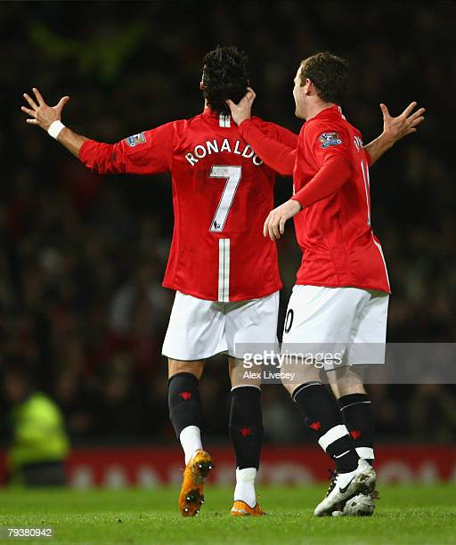 Cristiano Ronaldo of Manchester United is congratulated by team mate Wayne Rooney after scoring his team's second goal during the Barclays Premier...
