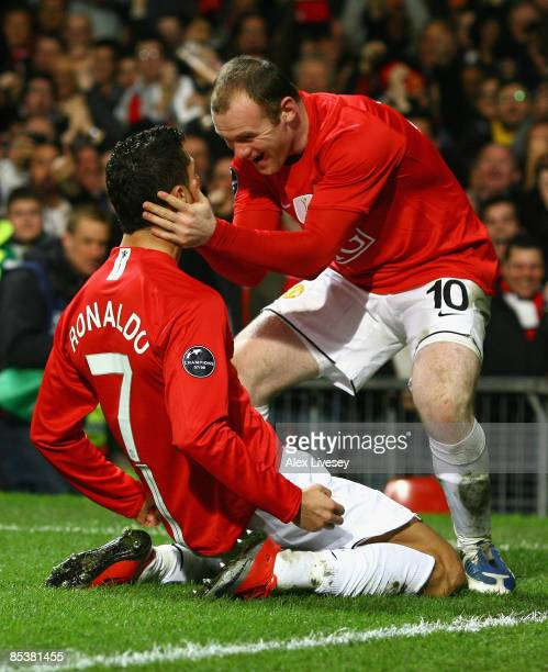 Cristiano Ronaldo of Manchester United is congratulated by team mate Wayne Rooney after scoring his team's second goal during the UEFA Champions...