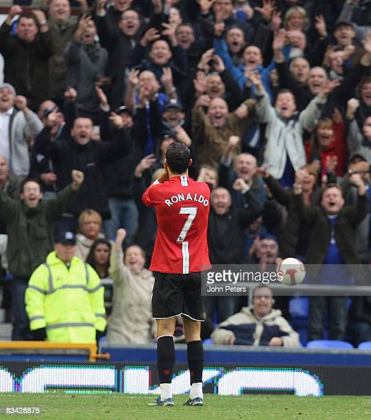 Cristiano Ronaldo of Manchester United is mocked by the home fans during the Barclays Premier League match between Everton and Manchester United at...