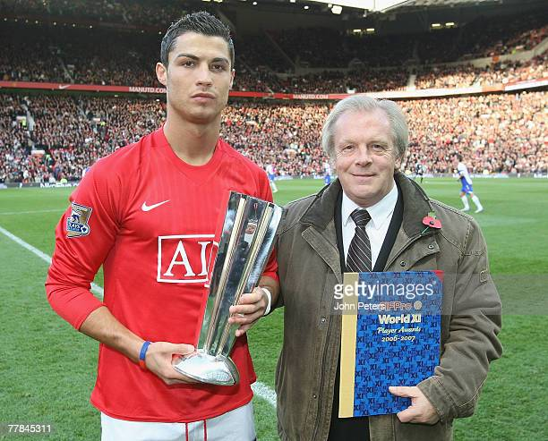 Cristiano Ronaldo of Manchester United is presented with a FIFPro award by Gordon Taylor ahead of the Barclays FA Premier League match between...