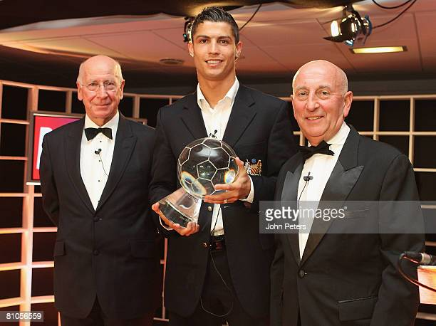 Cristiano Ronaldo of Manchester United is presented with his Goal of the Year award by SIr Bobby Charlton and bookmaker Fred Done during the annual...