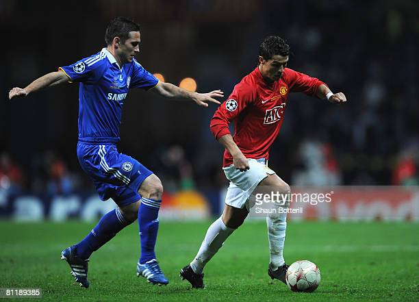 Cristiano Ronaldo of Manchester United is pursued by Frank Lampard of Chelsea during the UEFA Champions League Final match between Manchester United...