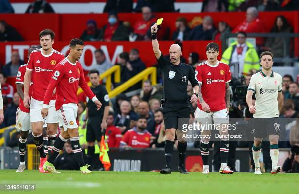 Cristiano Ronaldo of Manchester United is shown a yellow card by referee Anthony Taylor during the Premier League match between Manchester United and...