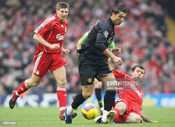 Cristiano Ronaldo of Manchester United is tackeled by Javier Mascherano of Liverpool as Steven Gerrard approaches during the Barclays FA Premier...