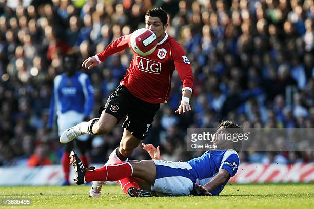 Cristiano Ronaldo of Manchester United is tackled by Dejan Stefanovic of Portsmouth during the Barclays Premiership match between Portsmouth and...