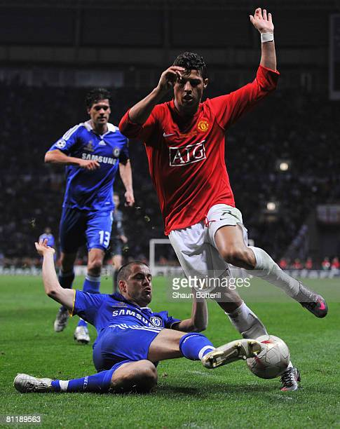 Cristiano Ronaldo of Manchester United is tackled by Joe Cole of Chelsea during the UEFA Champions League Final match between Manchester United and...