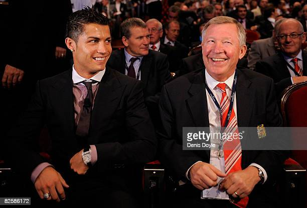 Cristiano Ronaldo of Manchester United laughs with his manager Sir Alex Ferguson while attending the UEFA Champions League Draw for the 2008/2009...